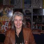 Louise de Grosbois (EspaceTrad) devant le stand Folquébec/EspaceTrad